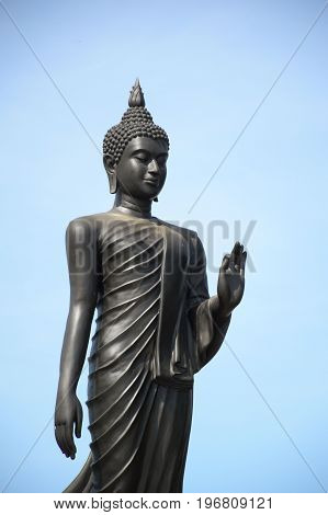 close up Standing black buddha in public temple