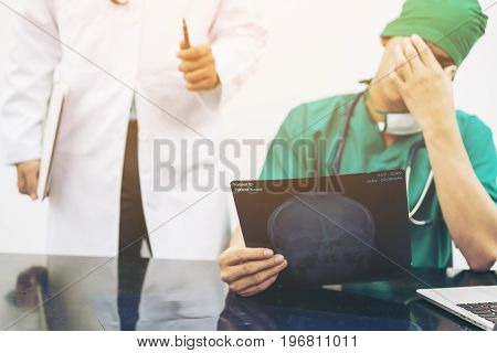 Doctor Covering His Face With Hand.