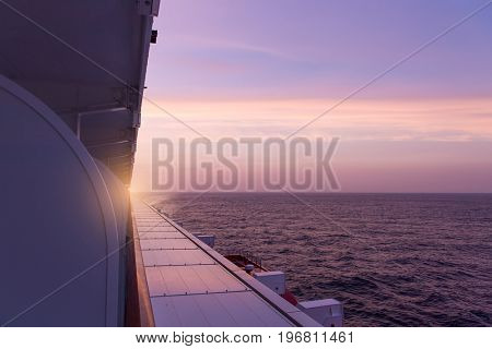 view of luxury ocean liner deck in sunset