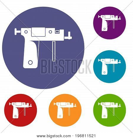 Piercing gun icons set in flat circle red, blue and green color for web