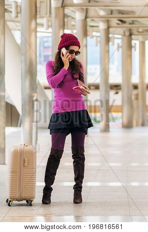 Woman Traveller Using Smartphone. Travel Concept.
