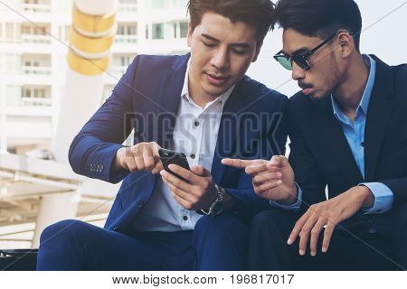 Two Business People Discuss Business Affair On Mobile Phone