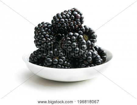 Tasty ripe blackberries in bowl isolated on white background.