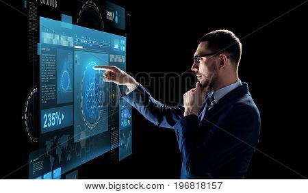 business, technology and people concept - businessman in suit with virtual screen projection over black background