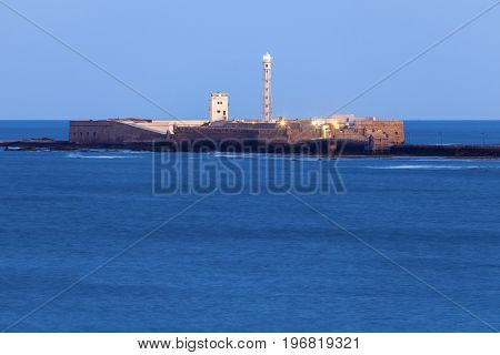 Panorama of Cadiz with the lighthouse seen at night. Cadiz Andalusia Spain.