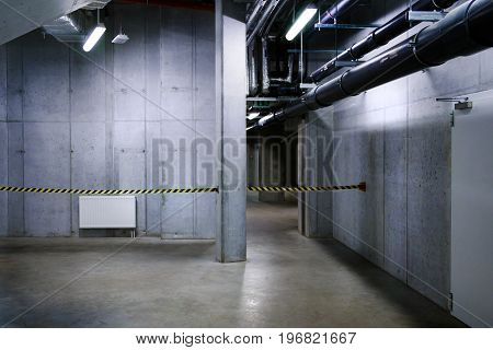 Industrial environment in room and corridor with cement walls and floor. Copy space for your text.