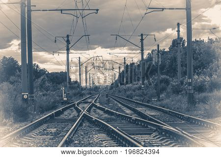 Old vintage photo. Landscape Railways with Turnouts On a cloudy day