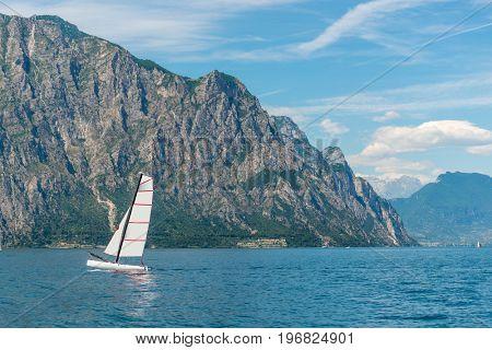 Beautiful peaceful lake Garda, Italy. Sailing boat.