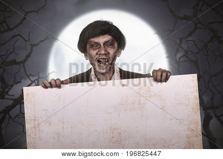 Scary Asian Zombie Man With Wounded Face With Empty Banner