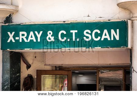 Medical office sign with various departments at Udaipur, India.