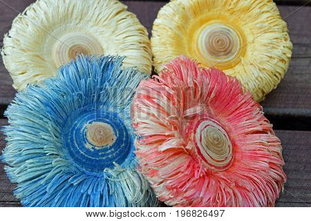 Colorful wooden flowers, made with wood lathe.