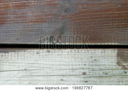 Wooden terrace boards. One with wood oil and another without protect against moisture and dirt.