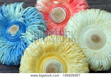 Close up of colorful wooden flowers, made with wood lathe.