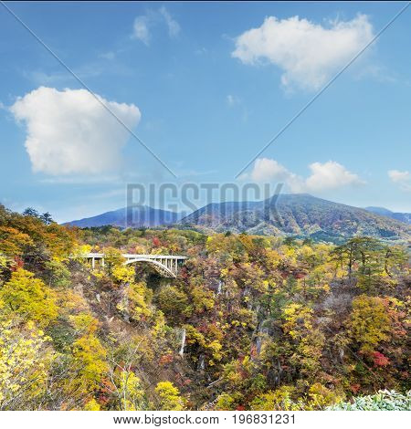 Autumn Colors Of Naruko Gorge In Japan And Nice Blue And Cloud Background