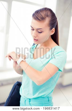 picture of surprised student girl looking at wristwatch