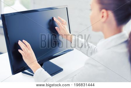business, office, school and education concept - smiling businesswoman with touchscreen in office