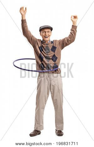 Full length portrait of a cheerful senior with a hula hoop isolated on white background