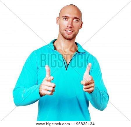sporty man shows thumb up and smiliing