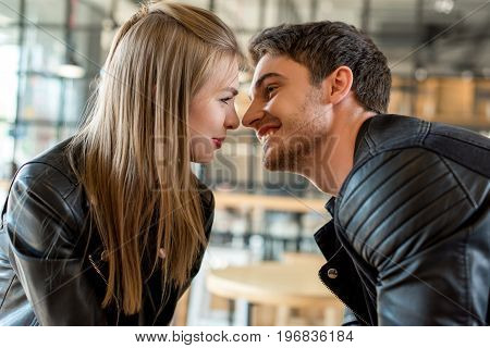 Side View Of Young Happy Couple In Love Looking At Each Other