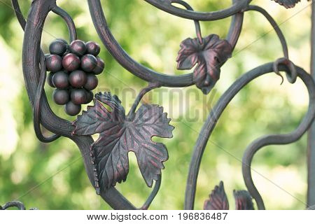 A decorative element of a fence from metal. Hand forging
