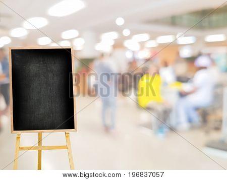 vintage menu blackboard on the background of blur hospital interior
