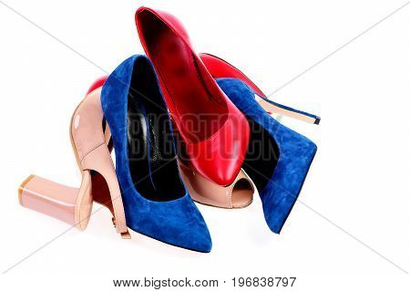 Pile Of Womens Shoes In Various Colours