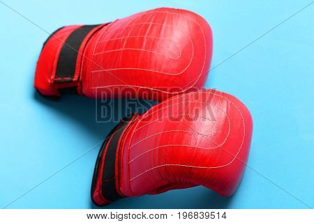 Boxing Gloves In Red Color. Sport Equipment Isolated On Blue