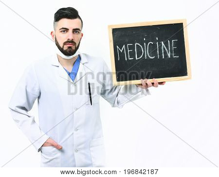 Man With Serious Face In White Medical Gown