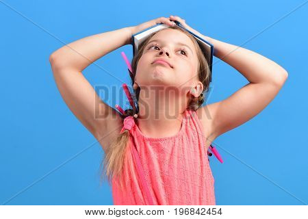 Kid In Pink Dress With Braids And Pencils In Hair