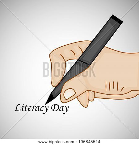 illustration of hand and pen with literacy day text on the occasion of Literacy Day