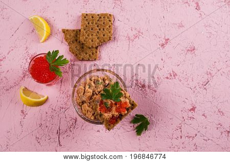 Pate of smoked salmon with caviar and parsley. Selective focus.