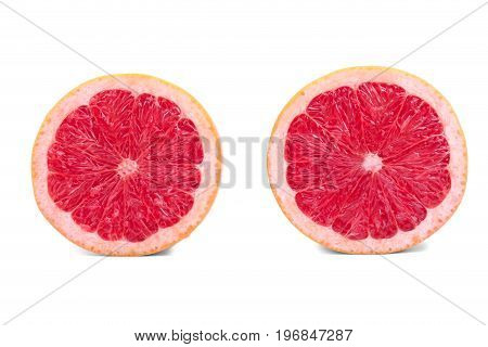 Grapefruit halves isolated on a white background. Two fresh, organic, exotic and juicy grapefruits full of vitamins. Citrus fruits for healthy snack. Slice of ripe and bright red grapefruit.