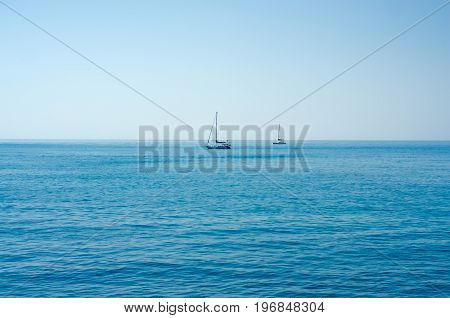 Two boats with sails in the blue sea nature