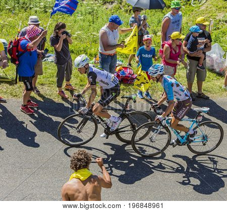Col du Grand ColombierFrance - July 17 2016: Serge Pauwels of Team Dimension Data and Alexis Vuillermoz of Team AG2R La Mondiale riding in a hairpin curve at Col du Grand Colombier in Jura Mountains during the stage 15 of Tour de France 2016.