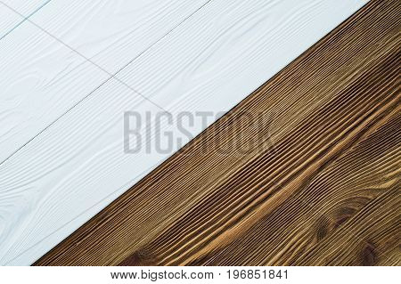 Contrast wooden background white and brown. Two wooden structures.