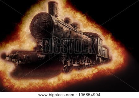 Old steam locomotive with special effect coming through fire on the track