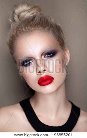 Beautiful young model with professional fashion rock make up with white eyebrows . Smoky eyes and red lips. Grunge rock style