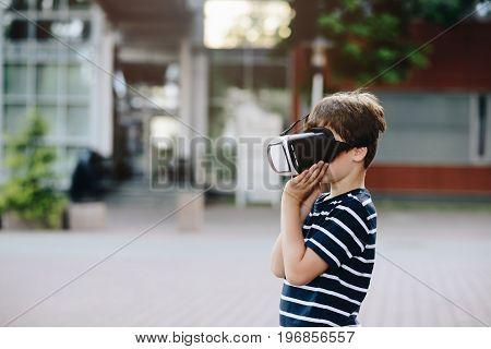 Boy Watching Simulation In Virtual Reality Googles