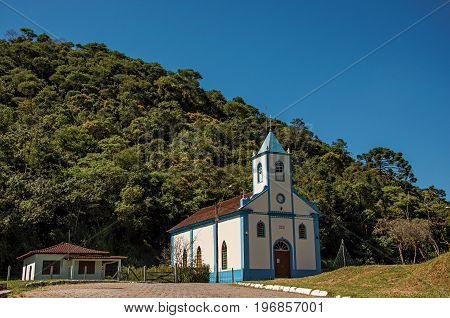 Visconde de Mauá, Brazil - January 19, 2015. View of small church with belfry and forest in Visconde de Mauá, a village in the middle of mountains an trees. Rio de Janeiro State, southwestern Brazil