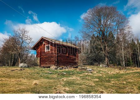 Old abandoned half-timbered log cabin on the Swedish countryside