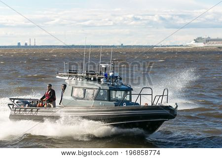 St. Petersburg Russia - 28 June 2017: the boat with splashes goes along the Neva River in St. Petersburg