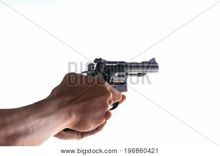 Man holding a gun in his hand with  isolated background.