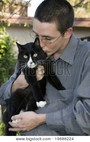 poster of Man with black and white cat