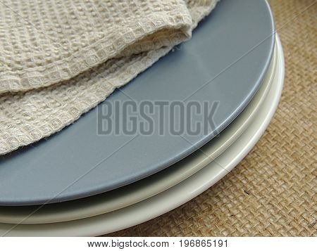 Matte plates with linen towel on burlap background, food photo props.