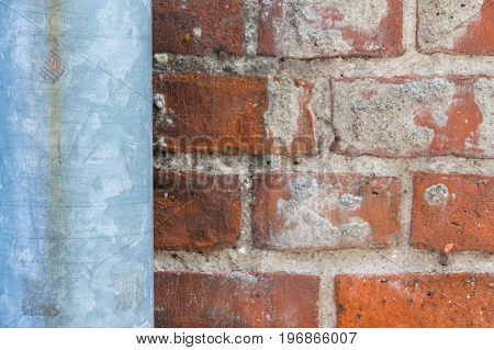 old drain pipe and brick wall background and texture for graphic design