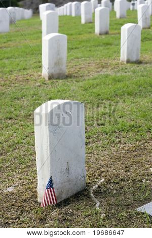 Small american flag marking a solider's grave