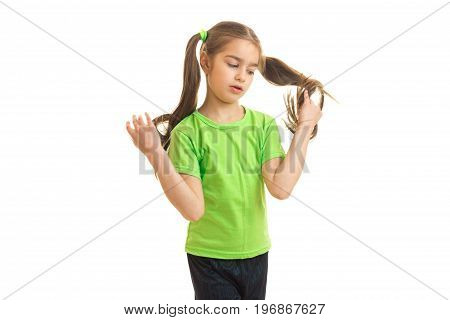 Cutie girl in green shirt posing on camera isolated on white background