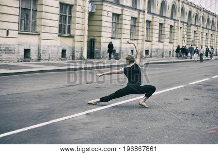 Saint Petersburg Russia - 16 July 2017: Photoshoot of ballet dancers on Architect Rossi Street near Vaganova Ballet Academy