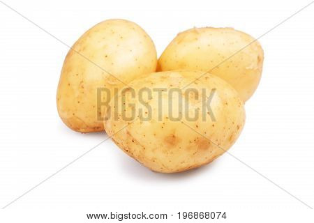 Three whole, raw, fresh and hard potatoes, isolated on a white background. Summer harvest tasty and new potatoes. Uncooked new potatoes, close-up. Fresh vegetables.