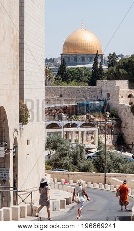 Jerusalem Israel July 14 2017 : Tourists are walking along the Ma'ale HaShalom Street in the direction of the Al-Aqsa Mosque in the Old City of Jerusalem Israel